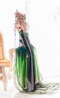 Bjd in a long flowing green gown