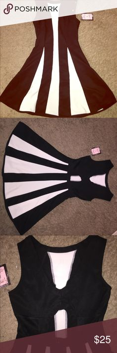 🔥 New Fancy Black/White Dress  With Back Cut-Outs Fancy Black/White Dress  With Back Cut-Outs SizeMedium.  97% Polyester, 3% Spandex Mesh 100% Polyester- Brand New Dresses