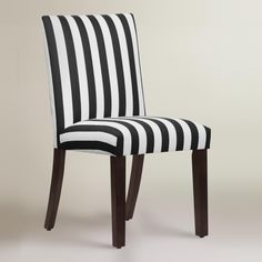 Featuring a modern silhouette designed for comfort, our custom-made dining chair is handcrafted in the U.S.A. of solid pine wood with bold black and white stripe upholstery in a soft cotton fabric. Accentuate your dining decor with this fashion-forward side chair, mix with your current chairs, or pair it with a vanity or accent table.