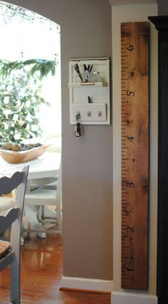 Oversized ruler growth chart for a child.  I'm picturing this in a nursery/baby's room.