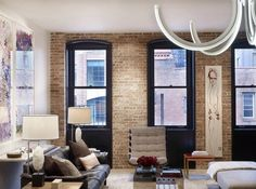 Tribeca Residence by Dirk Denison Architects. I really like the black windows against the brick.