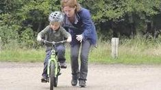 teaching a child to ride a bike