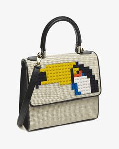 Les Petits Joueurs Mini Alex Tucano Bag   Inspired by a pop tropical mood, this natural raffia bag is sure to make you smile with a Lego toucan mosaic.