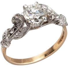 Edwardian 0.84 Carat Diamond Gold Platinum Engagement Ring. A beautiful Edwardian engagement ring featuring a 0.84ct I-SI2 diamond (EGL) and a gentle scrolling pattern accented with fine milegraining and pierced open work in platinum and 18k yellow gold, circa 1910s. Currently a US size 6.25 and easily adjusted. c 1910s