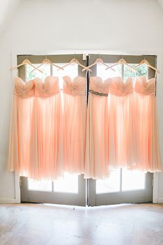 Elegant strapless peach bridesmaid dresses. @weddingchicks
