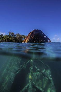 Pangaimotu Ship Wreck Photo by Emanuele Del Bufalo -- National Geographic Your Shot// Pangaimotu Island, Tonga Sea And Ocean, Pacific Ocean, Underwater Ruins, Abandoned Ships, Deep Blue Sea, Shipwreck, Abandoned Mansions, National Geographic Photos, Beach Resorts