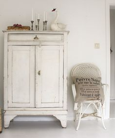 white cupboard - check out the swan!