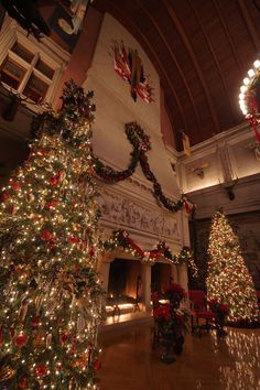 The triple fireplace in the 70-foot tall Banquet Hall inside Biltmore House in Asheville - decorated for Christmas 2014