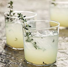 Limoncello-Gin Cocktail with Grilled Thyme: If you're firing up the grill already, throw some thyme sprigs over the fire to coax out the herb's floral qualities. Via FineCooking