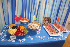 """""""Fish Food"""" = goldfish, """"Fruit of the Sea"""" = fruit platter, """"Peanut Butter and Jellyfish"""" = PBJ, """"Fish and Chips"""" = Onion Chip Dip with octopus bell pepper and chips, veggie cups with ranch.  Decorations Etsy"""
