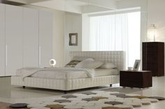 White color bedroom set with leather upholstered platform bed. Prime Classic Design offers infinite solutions to furnish the household environment in perfect harmony with current trends. It is the furniture suited for everyone s world thanks to its functionality and versatility. Their furniture wi...