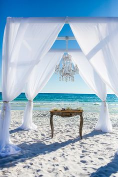 Use the stunning blues and greens of the ocean as an instant beautiful #beachwedding ceremony decor!
