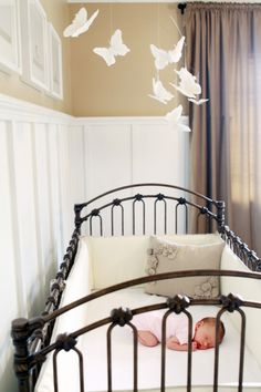 Love the crib...minus the padding on the sides.  That doesn't seem safe.  The mobile is adorable though...