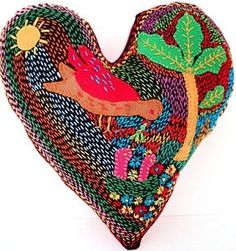 embroidered heart cushion made by the Forward Bear Project, a women's upliftment group in South Africa.