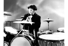 ALFRED HITCHCOCK POSING AS RINGO STARR OF THE BEATLES IN 1964