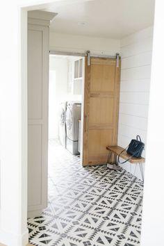 Beautiful painted floor!   Love the barn door as well....