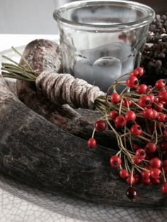 Candle & winter berries