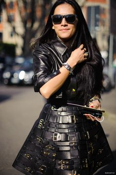 Loving this flared  woven belt skirt and leather jacket. #MFW #streetstyle #mizustyle