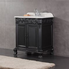 A classic vanity with a distinguishing presence, the Trent features an antique black finish, ornamental moldings and a large storage cabinet with double doors. The engineered marble top adds the perfect finishing touch to complete this distinctive look.
