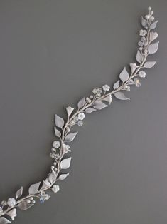 Are you looking for a soft, feminine hair vine with small leaves and flower buds detail in silver for your special day? This soft adjustable headpiece will make you feel effortlesly feminine, versatile, and wont give you that heavy and too much look I handmade this bohemian leaves hair vine, and Boho Bridal Hair, Bridal Hair Vine, Wedding Hair Flowers, Flowers In Hair, Bridal Hairpiece, Headpiece, Hair Garland, Silver Hair, Hair Jewelry