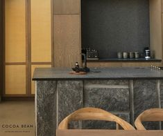 Using Harsh Strong Textures Such As Raw Cut Stone To A Space Could Be Quite Intimidating; We Took Off The Edge By Juxtaposing It With The Natural Rattan Detail On The Kitchen Doors As The Backdrop To The Rough Cut Stone Island In This Recent Cocoa Bean Lodge Project  Stone Is One Of Those Design Features That Are Not Only Durable, But It Also Flows Beautifully Into Most Design Themes. We Loved Using This Rough, Textured Granite In Our Space.  #CocoaBeanInteriorDesign #cocoabean…