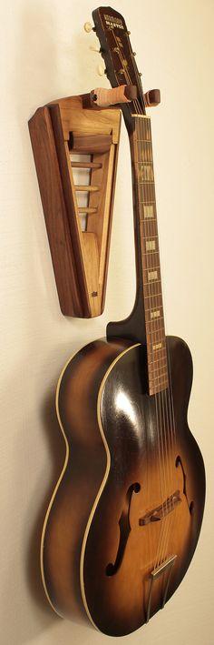 Our second wall mount guitar hanger design…walnut and butternut. http://atlas-stands.com/gear/stock/