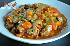 Hearty Slow Cooker Beef Stew - Low Carb, Paleo. The best beef stew I've ever tasted. I cooked it on the stove top. Did'nt add the bacon or mushrooms but I included cauliflower.