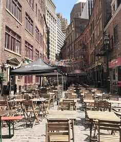 Stone Street, New York City. Old-World Charm in the Heart of Downtown Manhattan. You will find some of the best places to eat and drink in New York City on a narrow cobblestone street in the heart of the Financial District called Stone Street. (V)