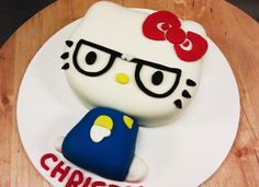 I so want to try this Today's cake of the day features a nerdy and angry Hello Kitty cake!