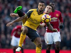 Matteo Darmian attempts to win possession from Theo Walcott as the Arsenal forward shields...