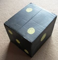 Make a giant dice out of a cardboard box and chalkboard paint!
