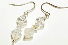 Check out this item in my Etsy shop https://www.etsy.com/listing/482562139/white-earrings-swarovski-crystal