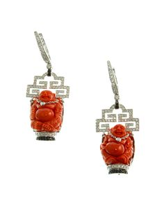 Coral Buddha with diamonds in white gold earrings. Designed by Lucille Dizon