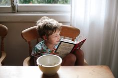 My future kid, reading at breakfast