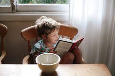 My future kid, reading at breakfast