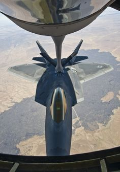10/24/2013 - An F-22 Raptor assigned to the 49th Fighter Wing, at Holloman Air Force Base, N.M., backs away from a KC-135 Stratotanker from McConnell Air Force Base, Kan., Oct. 23, 2013. Four Raptors were refueled over central New Mexico during this training mission. (U.S. Air Force photo/Airman 1st Class John Linzmeier)