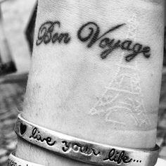 Wrist, black over white eiffel tower. Megan's tatt!