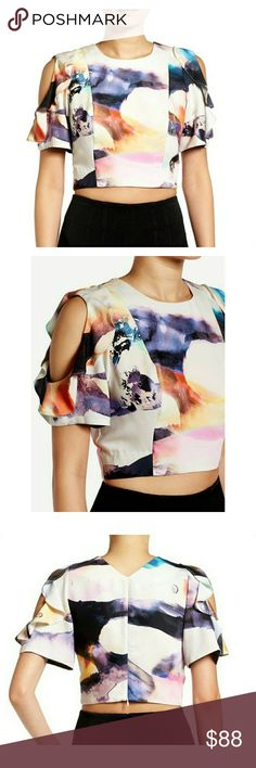 "NWT, KENDALL + KYLIE Ruffle Sleeve Crop Top Sculptural ruffles frame skin-baring cutouts on the short sleeves of a tailored crop top designed to make an ultra-modern statement. A gorgeous watercolor-inspired pattern finishes the avant-garde look with vibrant color and intriguing dimension. 18"" length (size Medium). Hidden back-zip closure. Crewneck. Short sleeves. Partially lined. 100% polyester. Machine wash cold, tumble dry low. By KENDALL + KYLIE; imported. Kendall & Kylie Tops"