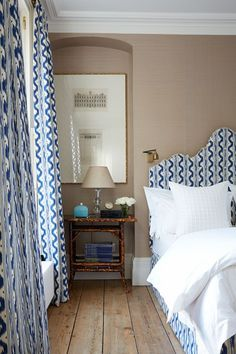 Headboard and drapes made from fabric, 'Palma Large' from Bernard Thorp. Headboard designed by designer Robert Moore.