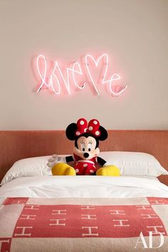 """Kourtney Kardashian - Chic toddler girl's room features a """"love me"""" light over a pink headboard on bed dressed in a watermelon pink Hermes Avalon Blanket."""