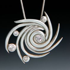 b2 Multiple faceted stones; Pendant by Cindy Miller.