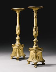 A pair of George III giltwood and gilt-gesso torchères Circa 1778, designed by Robert Adam for the Great Drawing Room at Apsley House, London, possibly executed by Sefferin Nelson with circular tops raised on baluster stems with tri-form bases applied with neo-classical decoration on paw feet