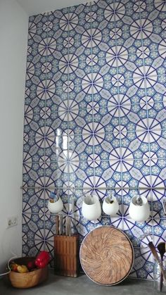 .Tile a wallin the kitchen or bathroom or one side of the wall to the edge of a ceiling to floor length cabinet.