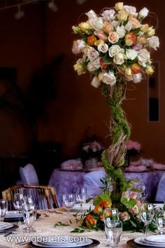 Oberer's Flowers- Beautiful floral centerpiece that could be recreated with the column and plate centerpiece set.
