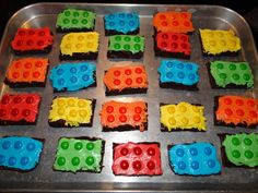Separate M's into color piles. Mix white whipped icing with food coloring to match the M's. Cut cooled brownies into rectangles.  Ice with colored icing, place 6 M's (logo side down) ontop of the icing (matching up the colors) and you have instant lego brownies!  This was a huge hit at school for a birthday treat!