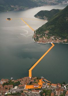 The Floating Piers project by Christo features bright orange pathways across Italy's Lake Iseo