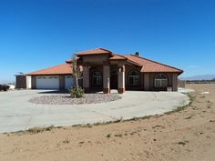 Horse Property for Sale in San Bernardino County in California. Beautiful home built in 2004 open and spacious with 2584 of living space. This home has formal dining and living room areas but are open to the kitchen and great room. Tall ceilings and gorgeous fireplace with a insert for those chilly winter nights. Built in shelves and niches. Large kitchen with lots of cabinets and pantry, center island built in oven and range and pot shelves.