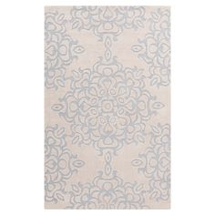 Hand-tufted rug with an oversized medallion motif.  Product: RugConstruction Material: 100% Polyester