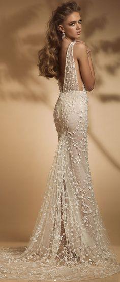 Sleeveless deep v plunging neckline heavy embellishment fit and flare wedding dress sweep train #wedding #weddingdress #weddinggown