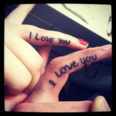 """I love you"" tattoo in each others hand writing on ring finger."